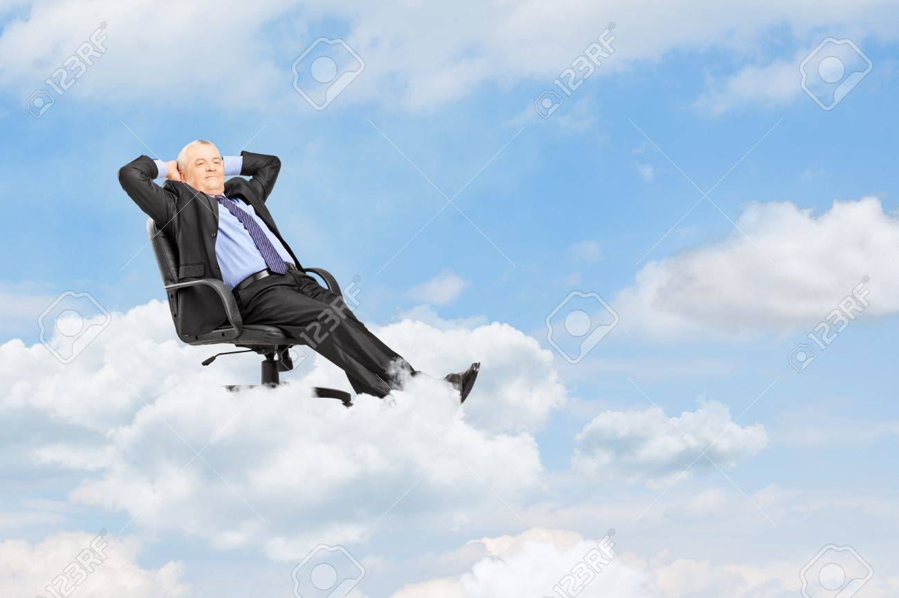 Mature businessman in suit resting in armchair and floating on a cloud Stock Photo - 22060617