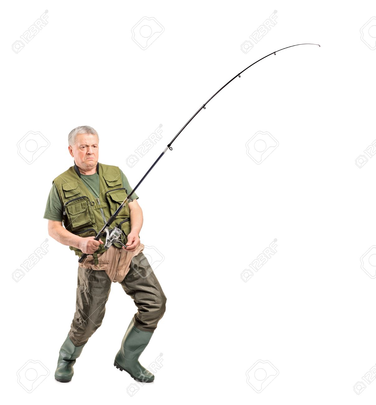 full length portrait of a mature fisherman holding a fishing stock