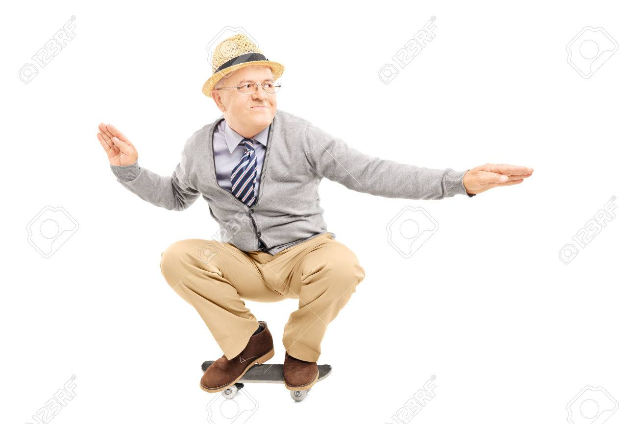 Senior man with hat riding a skateboard isolated on a white background Stock Photo - 24390574