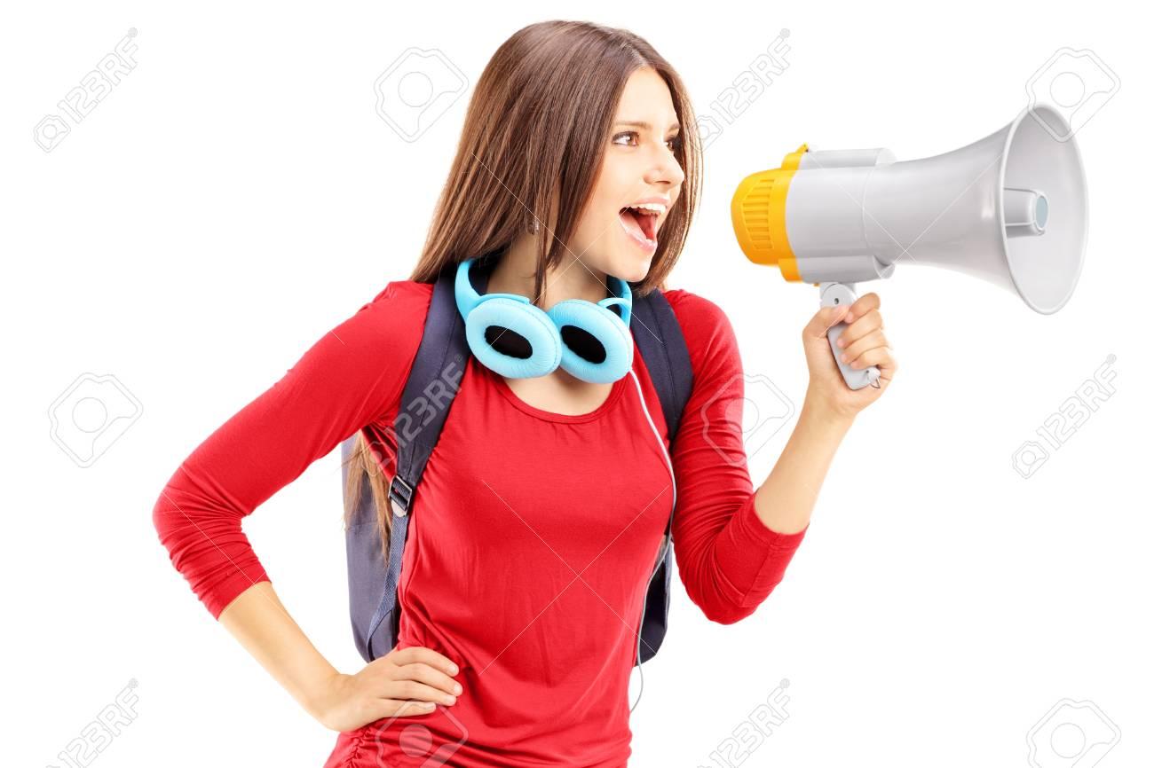 Female student shouting via megaphone isolated on white background Stock Photo - 24935063