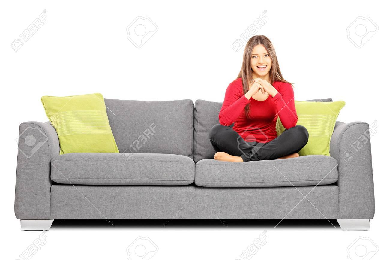 Pleasing Smiling Girl Sitting On A Sofa And Looking At Camera Isolated Squirreltailoven Fun Painted Chair Ideas Images Squirreltailovenorg