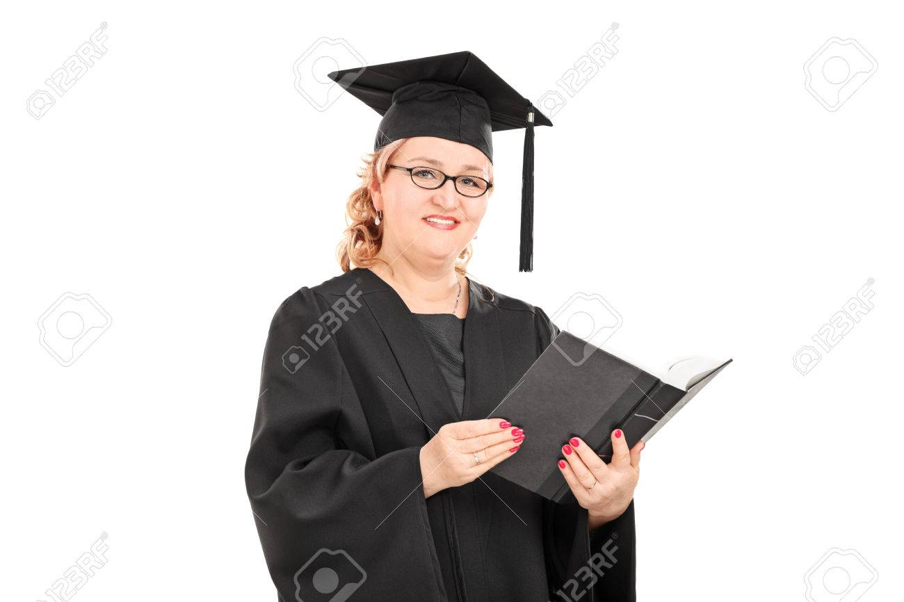 Woman In Graduation Gown Reading A Book Isolated On White Background ...