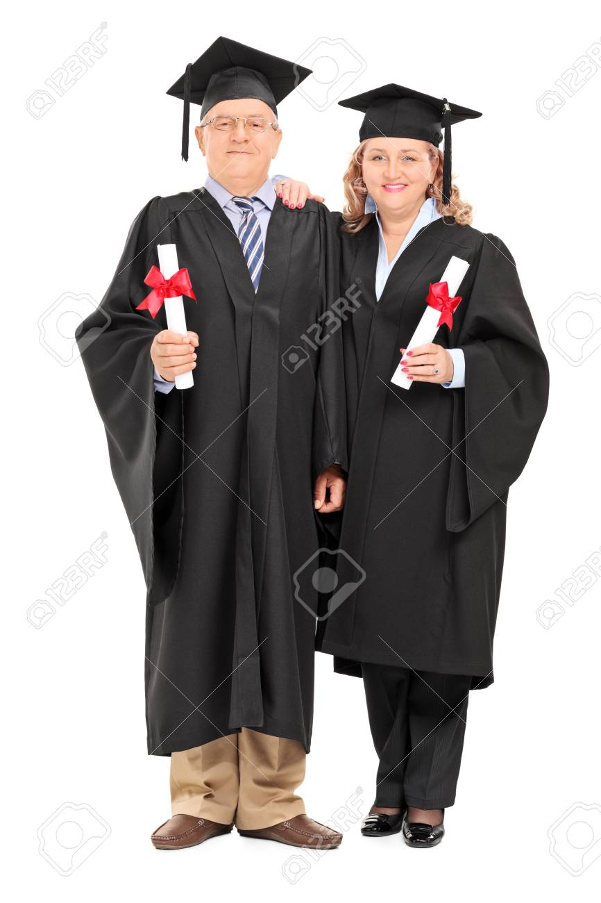 Full Length Portrait Of A Mature Couple In Graduation Gowns With ...