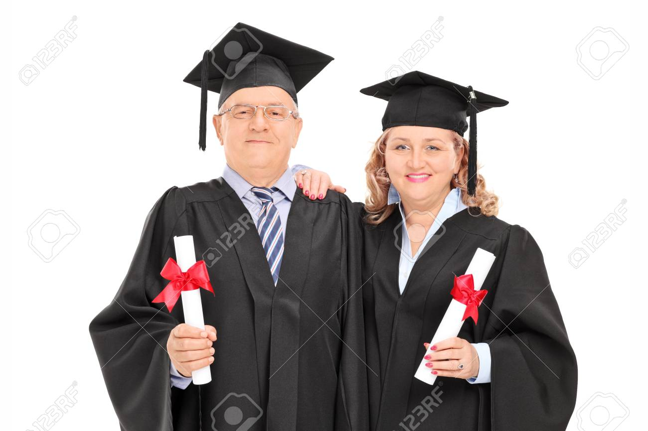 Mature Couple In Graduation Gowns With Diplomas Isolated On White ...