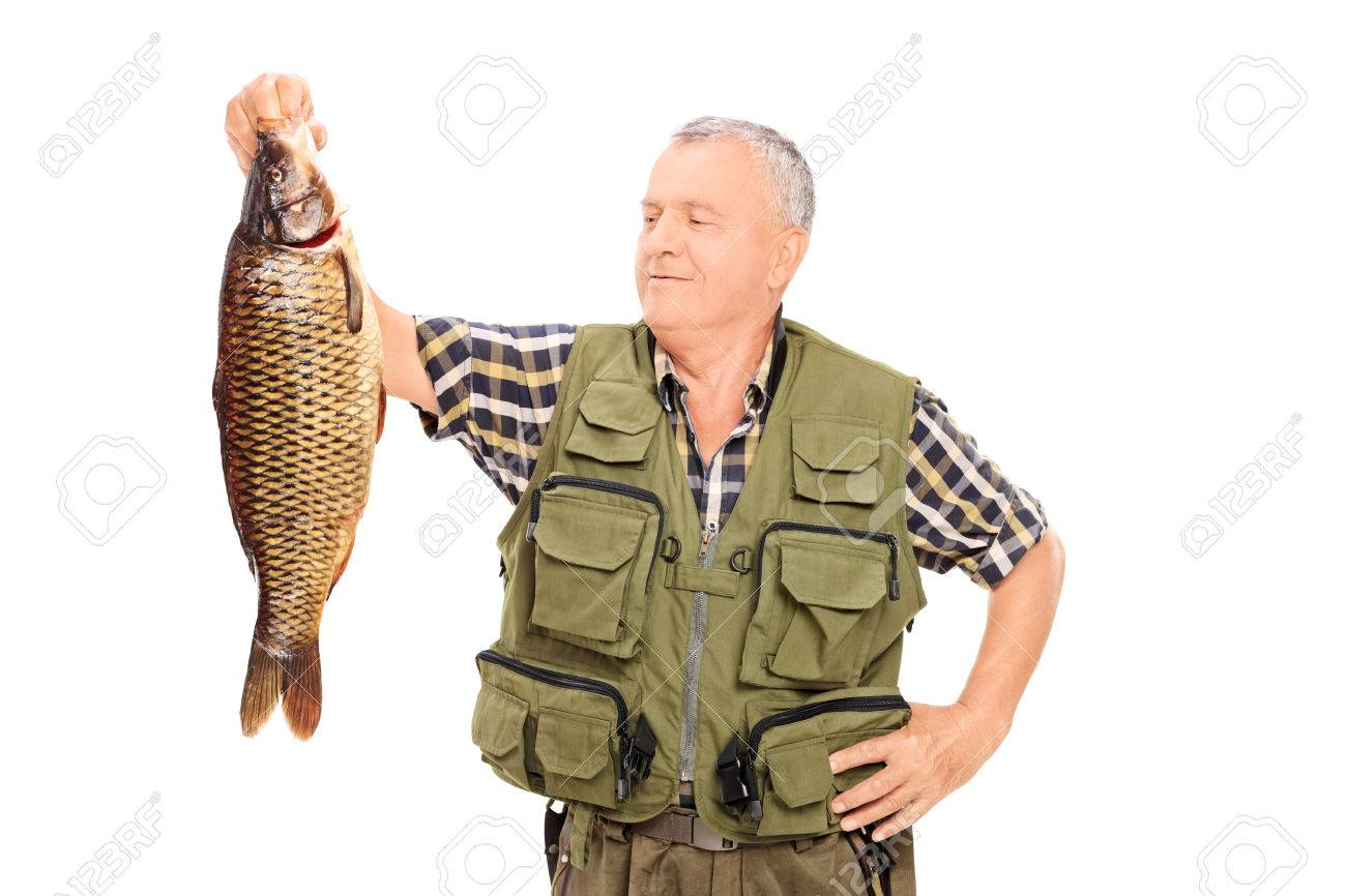 proud mature fisherman holding a big fish isolated on white