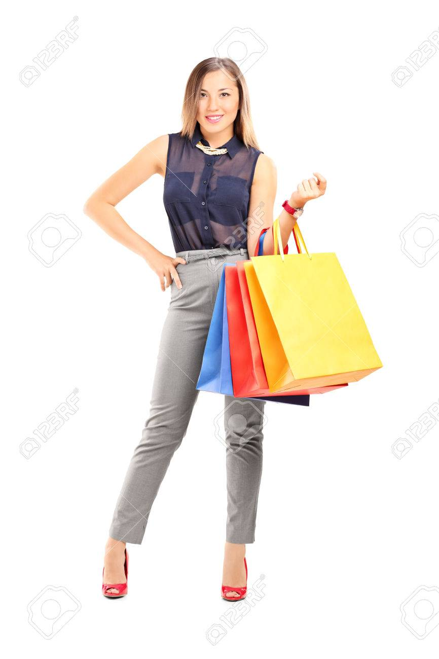 Woman posing with shopping bags isolated on white background full - Full Length Portrait Of A Trendy Girl Holding Shopping Bags Isolated On White Background Stock Photo