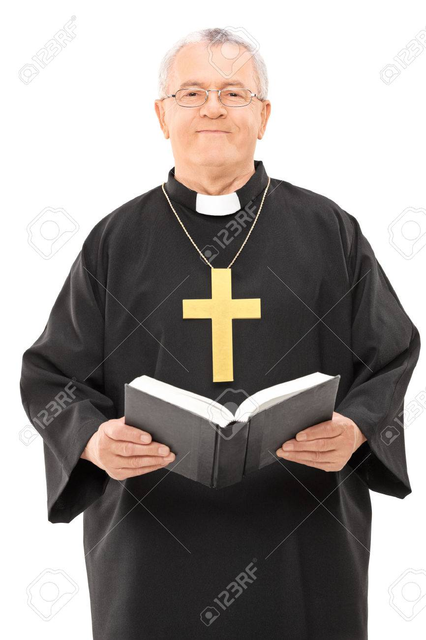 happy mature priest holding a holy bible isolated on white