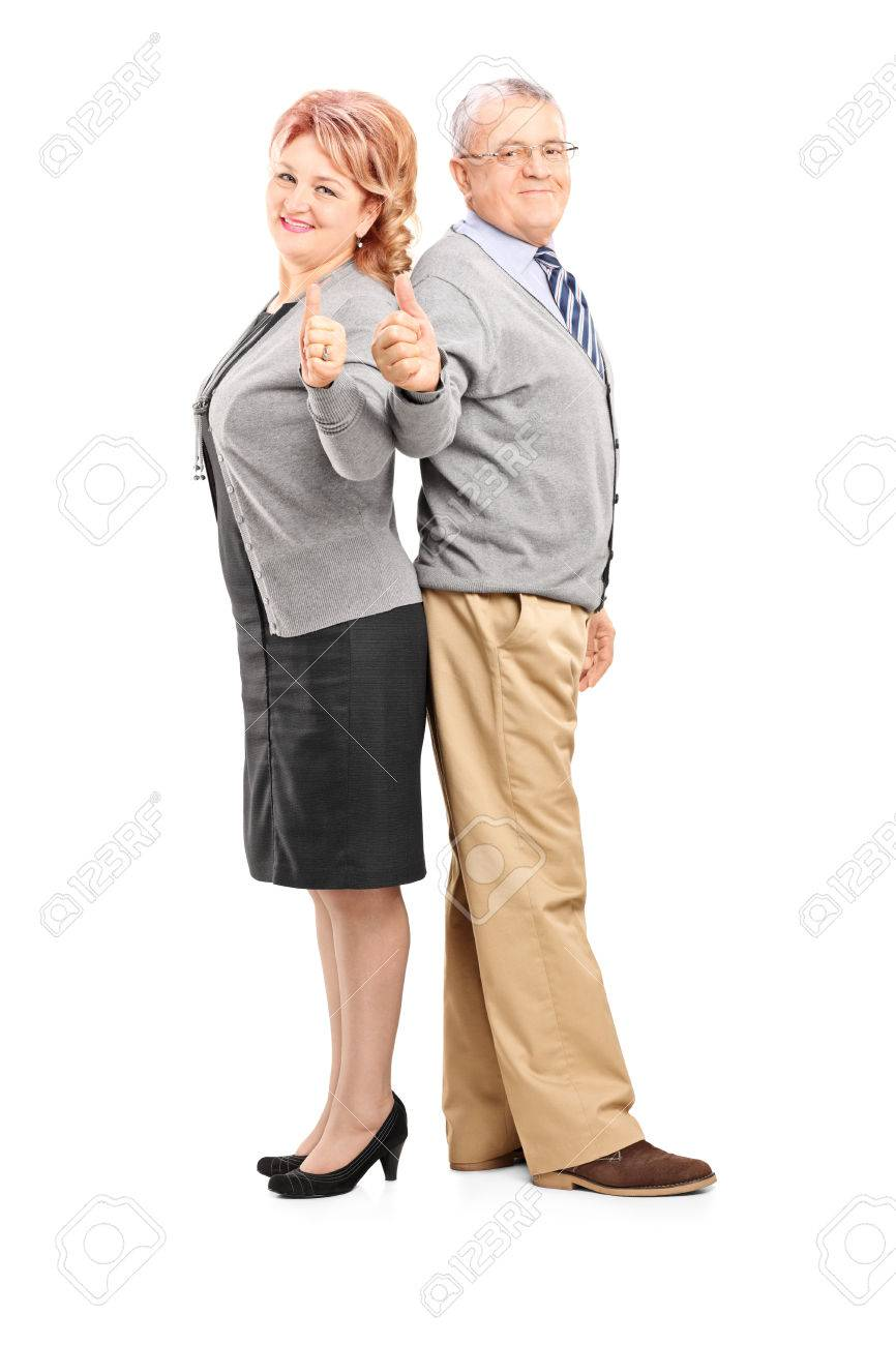 full length portrait of a happy mature couple giving thumbs up