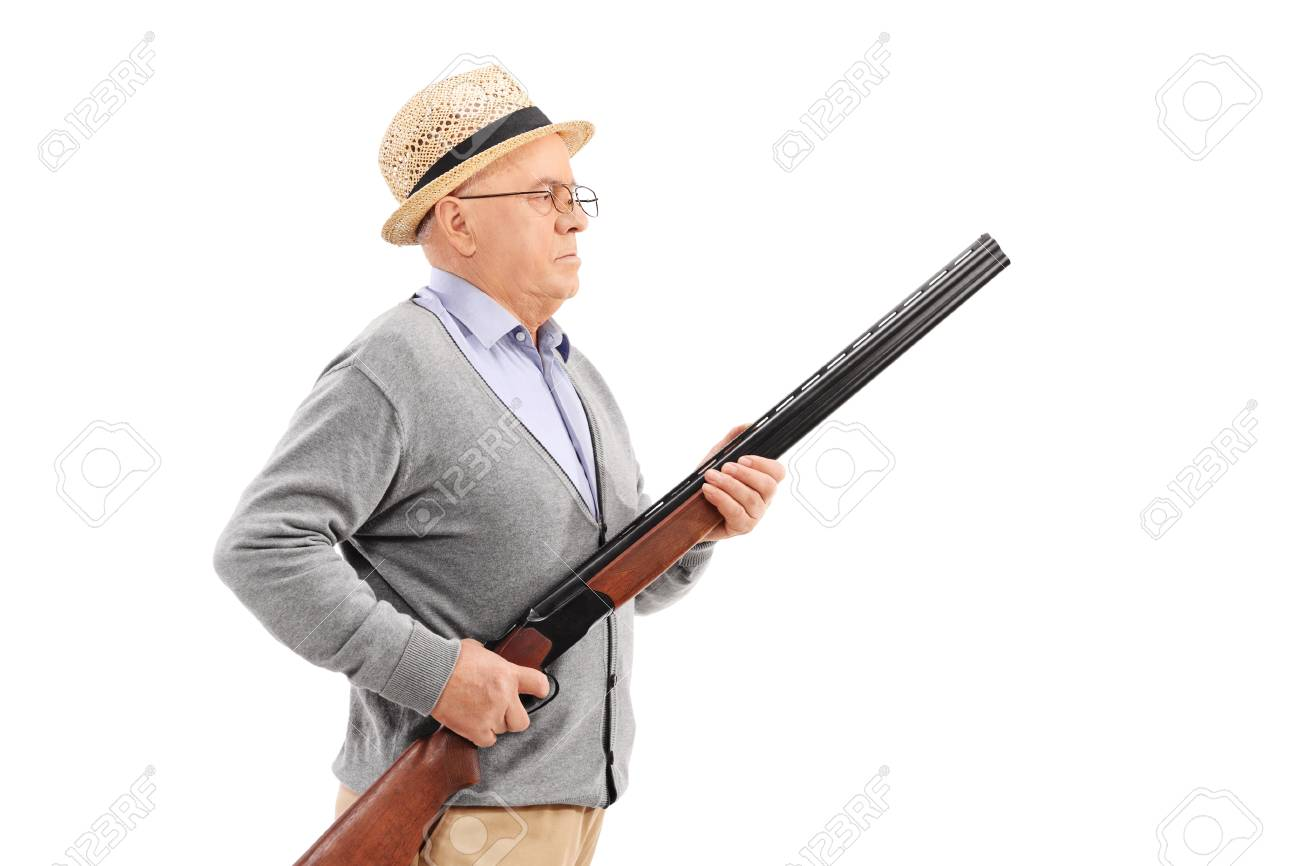 Senior gentleman with hat holding a rifle and standing in a row isolated on  white background 4203a8af39a5
