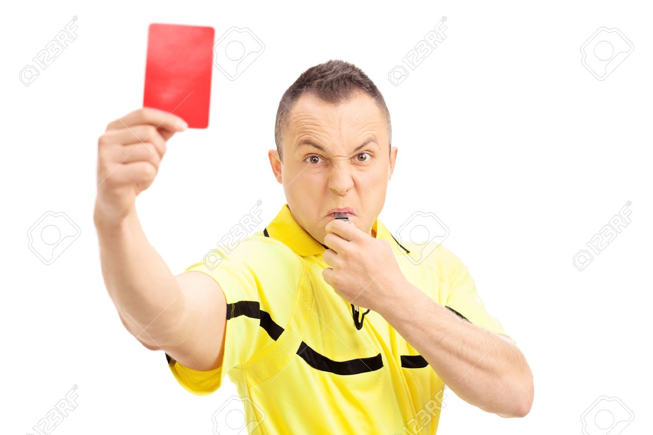 Furious football referee showing a red card and blowing a whistle isolated on white background - 39282145