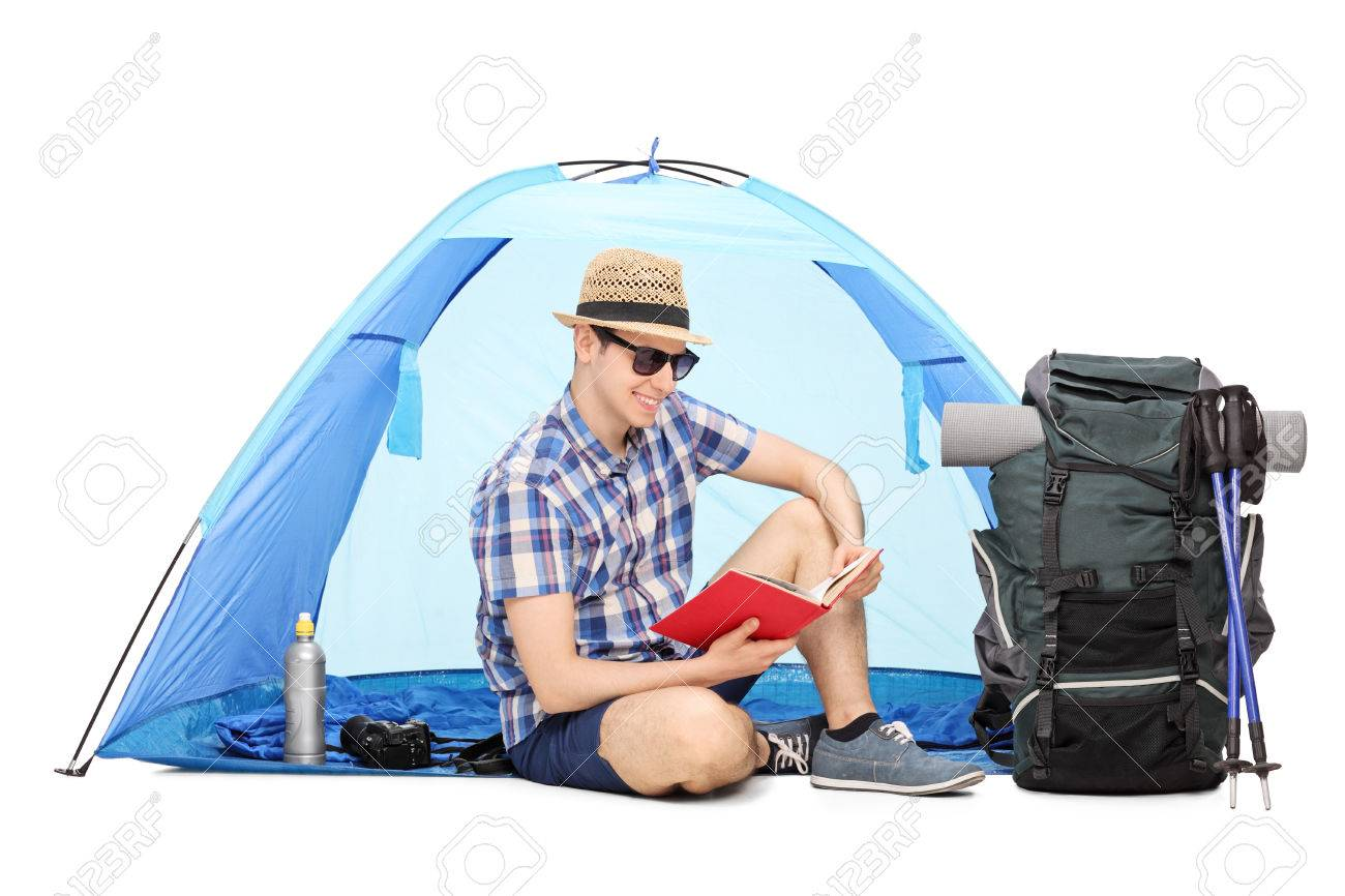 Young male c&er reading a book seated on the ground with a blue tent behind him  sc 1 st  123RF.com & Young Male Camper Reading A Book Seated On The Ground With A ...