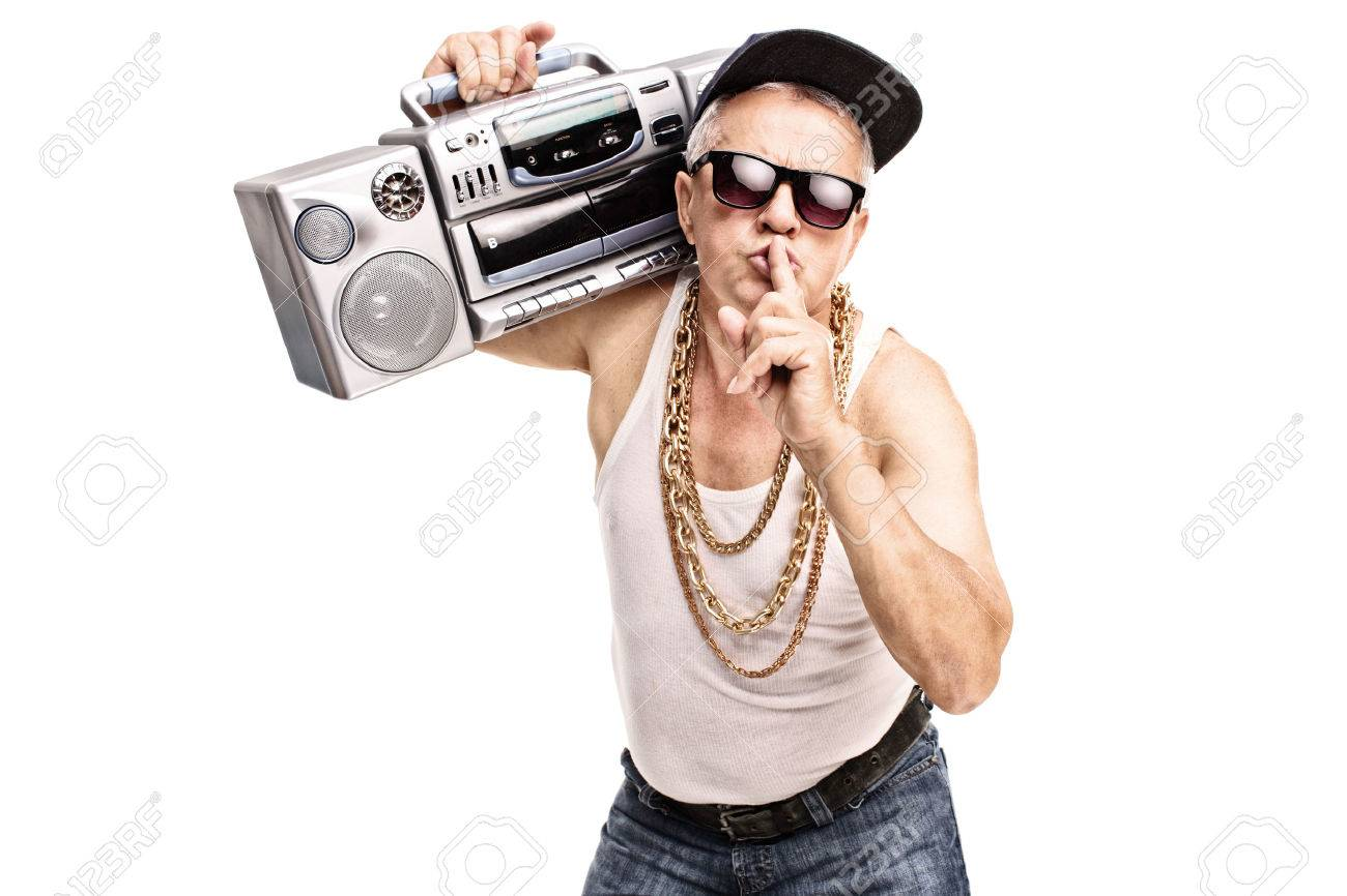 http://previews.123rf.com/images/ljupco/ljupco1507/ljupco150700042/42032416-Mature-man-in-hip-hop-clothes-carrying-a-ghetto-blaster-over-his-shoulder-and-holding-a-finger-on-hi-Stock-Photo.jpg