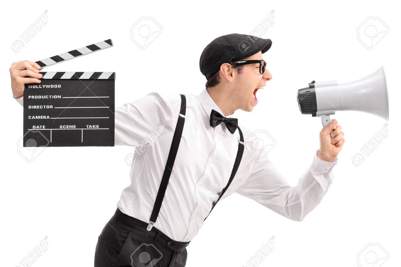 young movie director holding a clapperboard and shouting on a