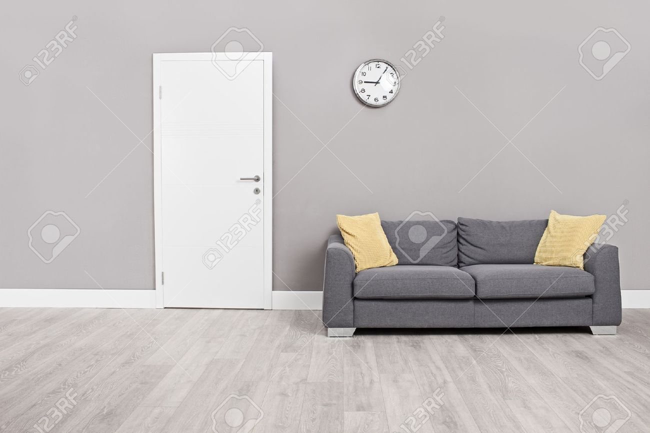 Empty Waiting Room With A Modern Gray Sofa In Front The Door