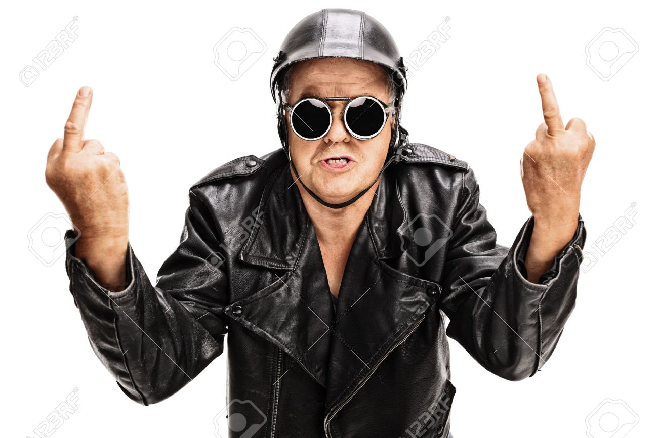 31a8ee9bedbb Studio shot of an angry senior biker showing middle finger with both hands  and looking at