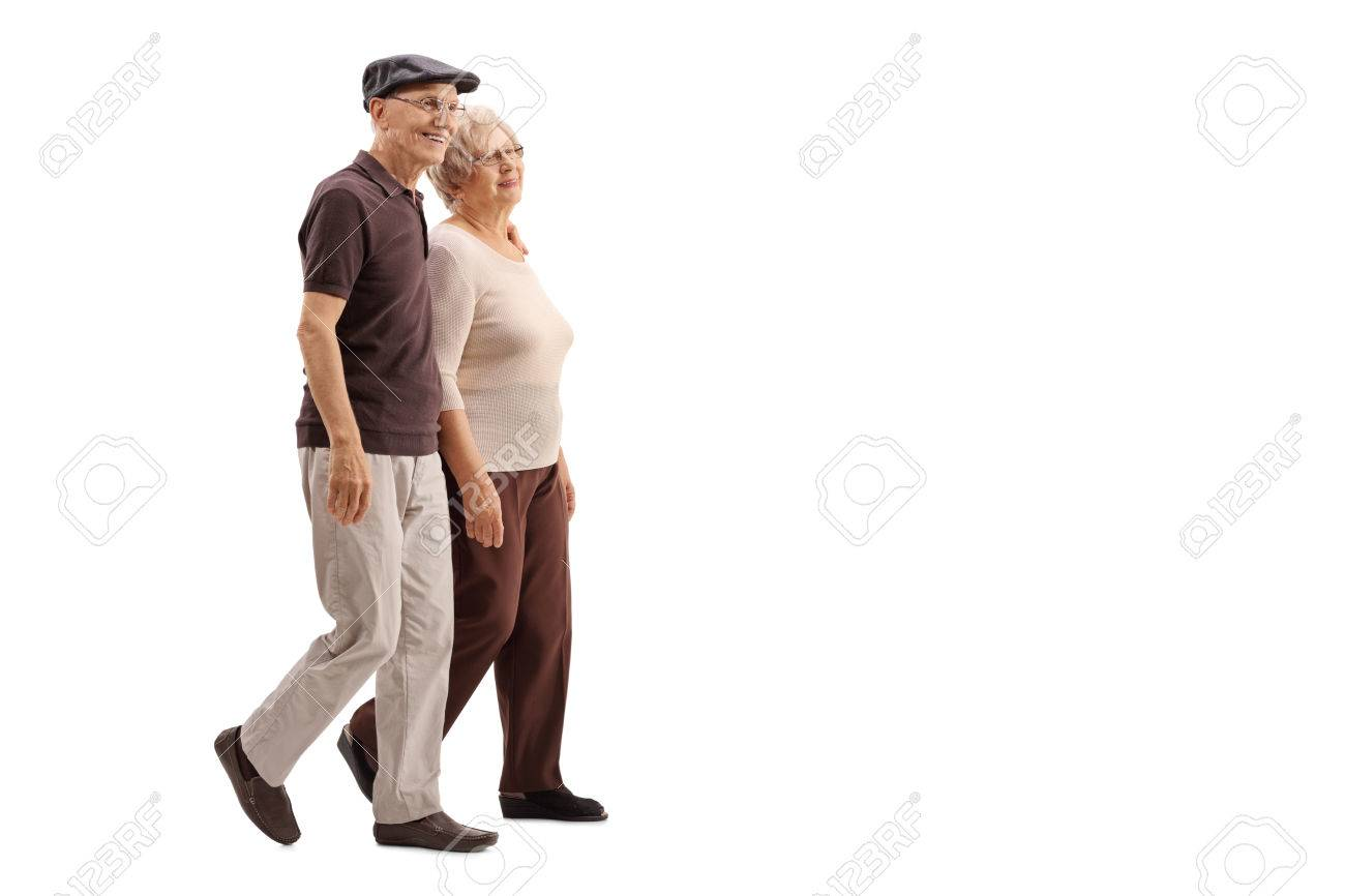 Mature couple walking together and smiling isolated on white background - 59151976