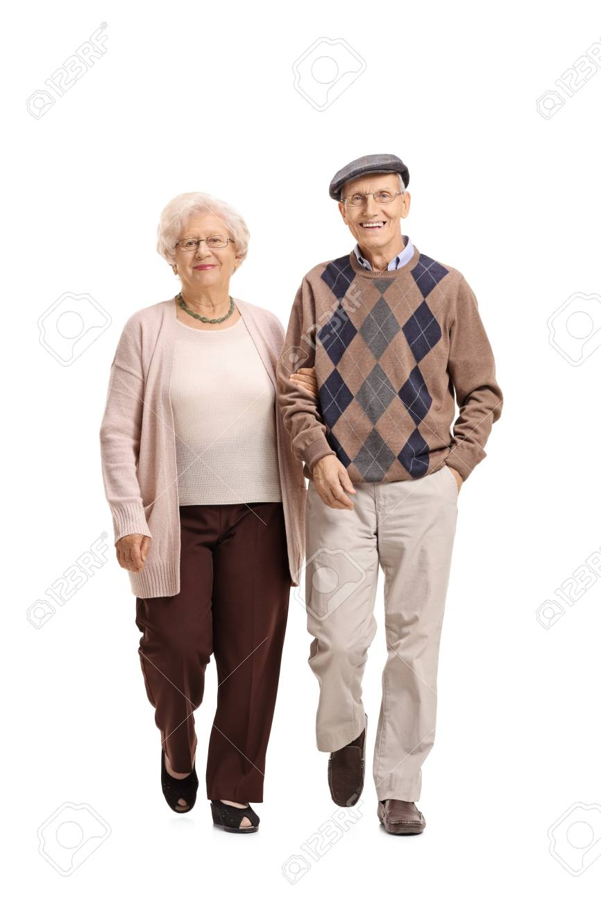 Full length portrait of an elderly couple walking towards the camera isolated on white background - 78703227