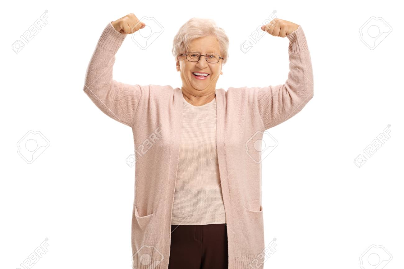 Cheerful mature woman flexing her muscles isolated on white background - 80690128