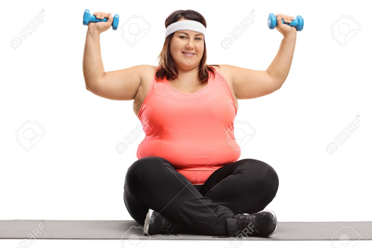 Overweight Woman Exercising With Small Dumbbells On An Exercise Stock Photo Picture And Royalty Free Image Image 88917876