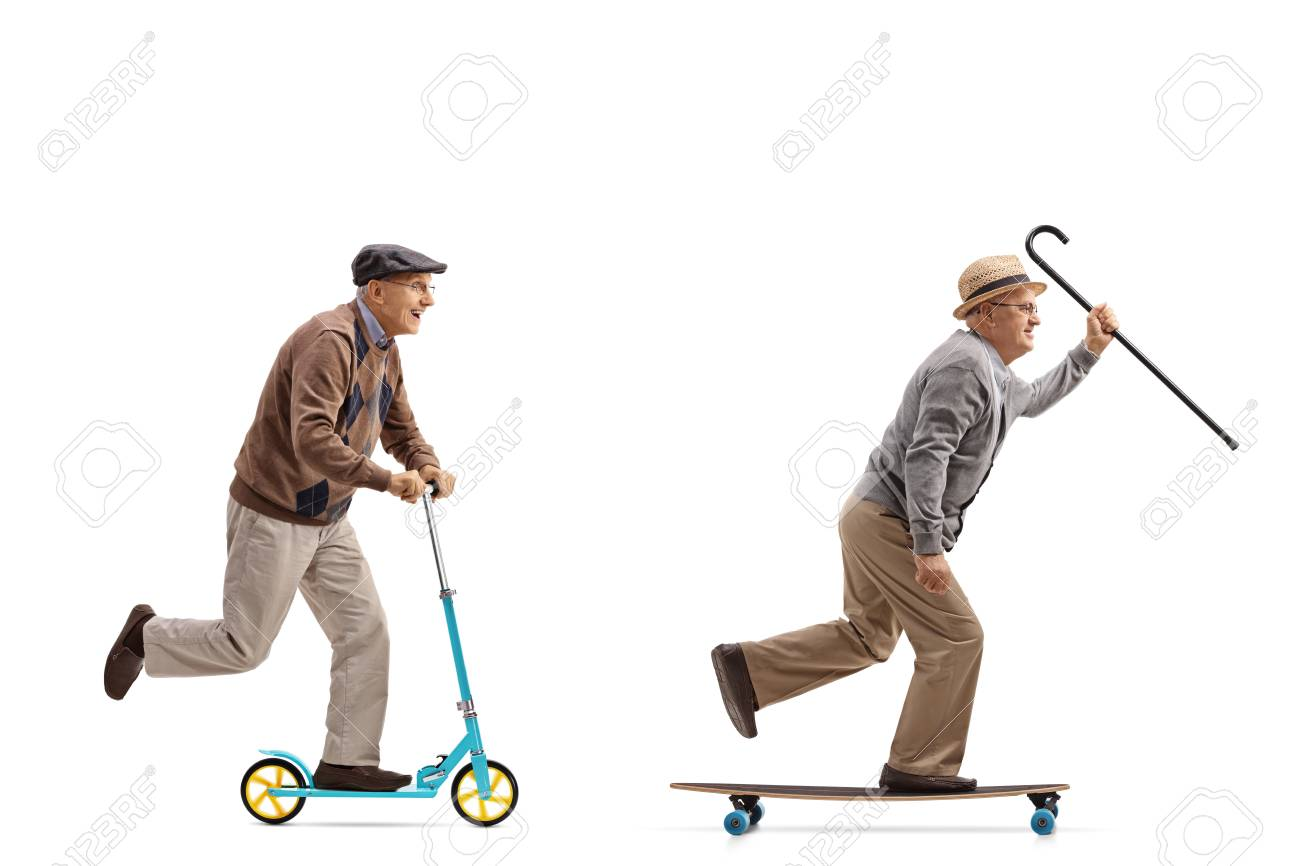 Full length profile shot of two elderly men with one of them riding a scooter and the other riding a longboard isolated on white background - 92263402