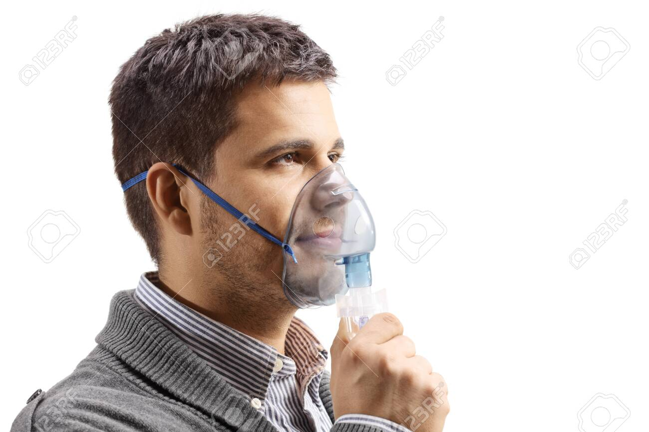 Young man with an inhalation mask isolated on white - 129912197