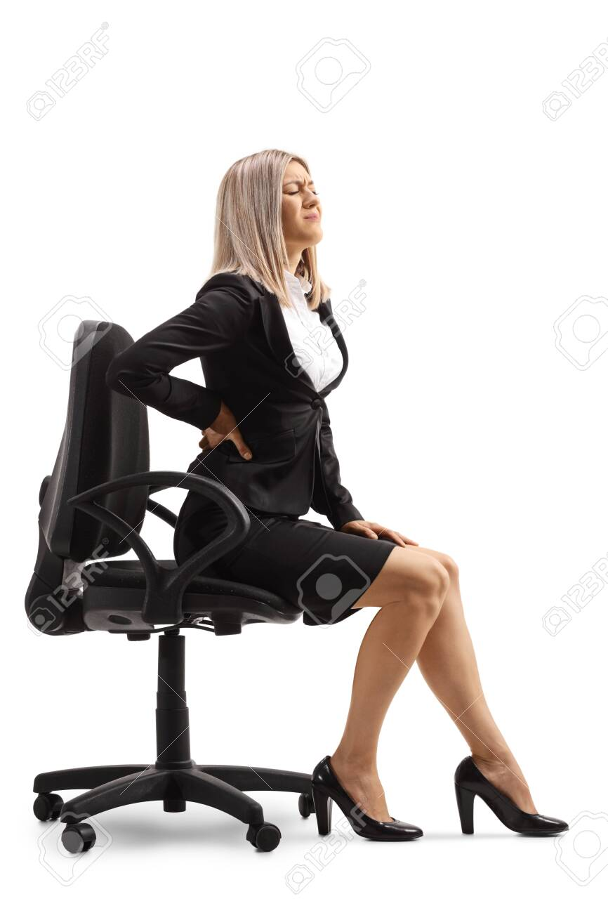 Young woman at work with a painful lower back sitting on a chair isolated on white background - 153677273