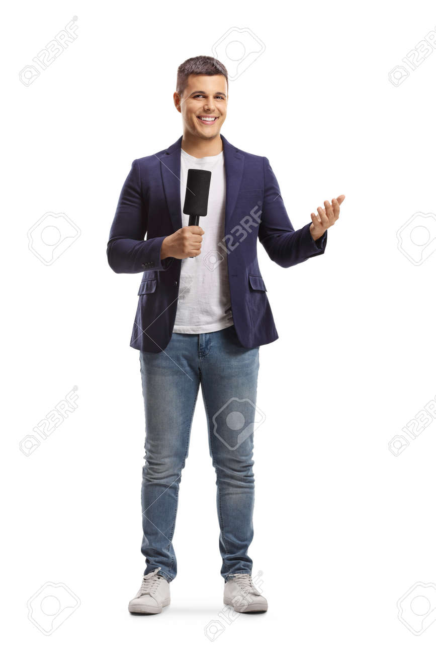 Full length portrait of male reporter holding a microphone and gesturing with hand isolated on white background - 164694362