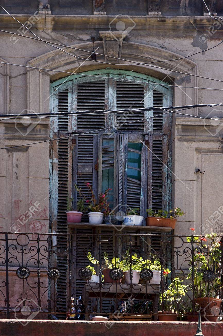 old   little terrace  blue green venetian blind and flower  in the centre of buenos aires la boca argentina Stock Photo - 18273821