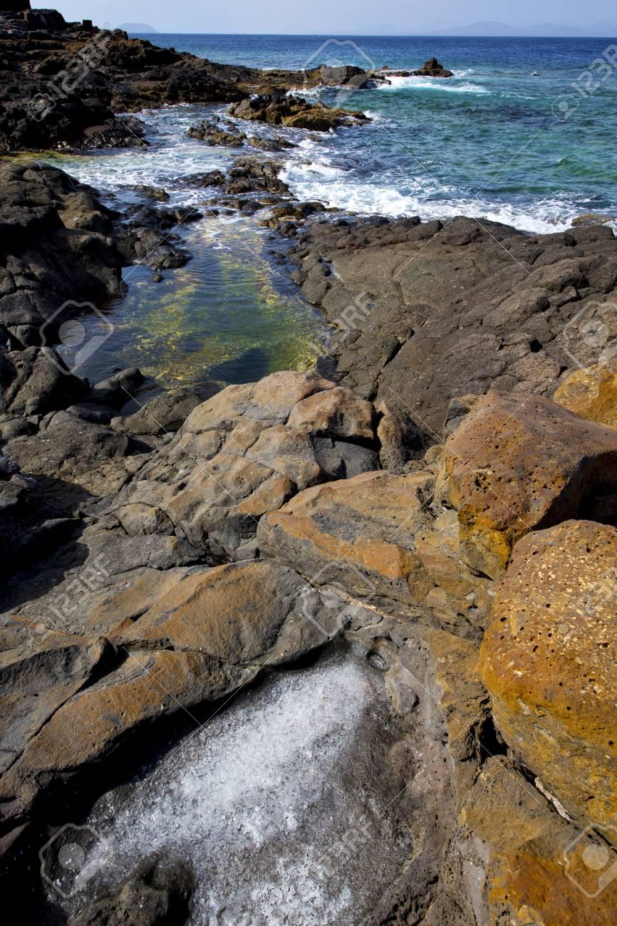 salt in lanzarote isle foam rock spain landscape stone sky