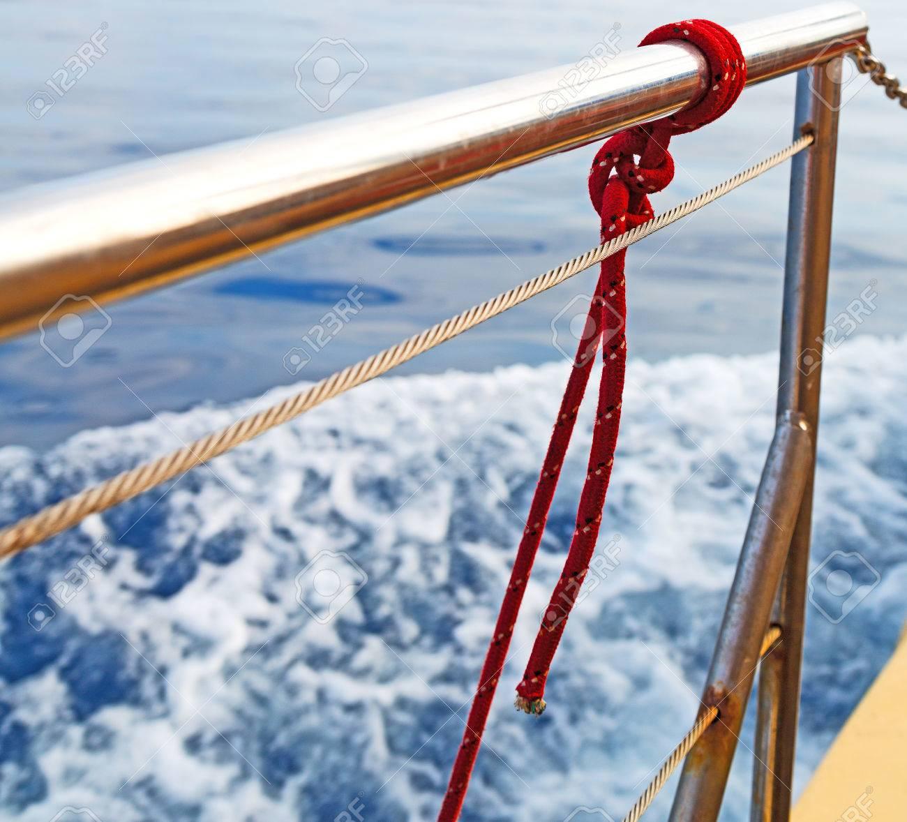 rope and metal in the blue skay aocean mediterranean sea - 52580172