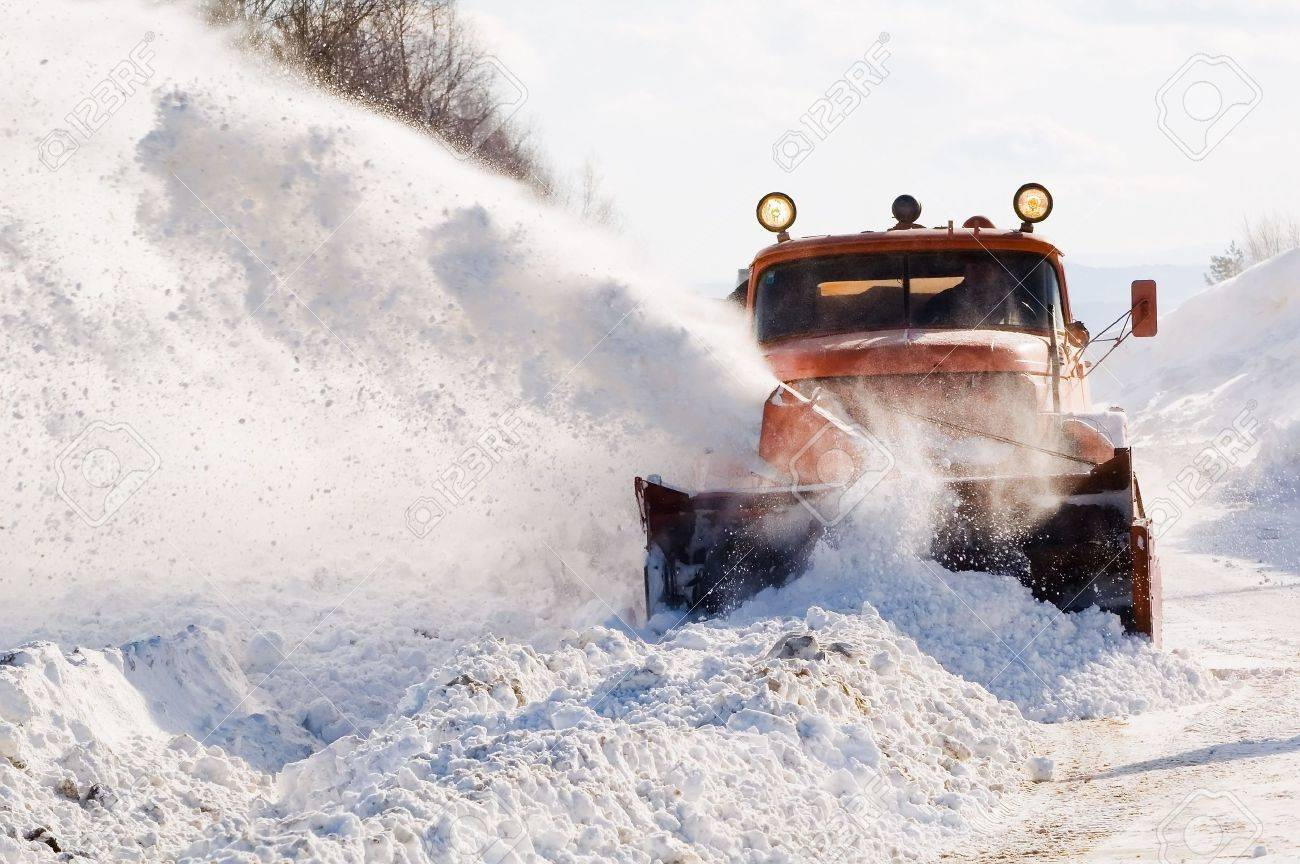 Snowplow removing snow from intercity road from snow blizzard Stock Photo - 2727473