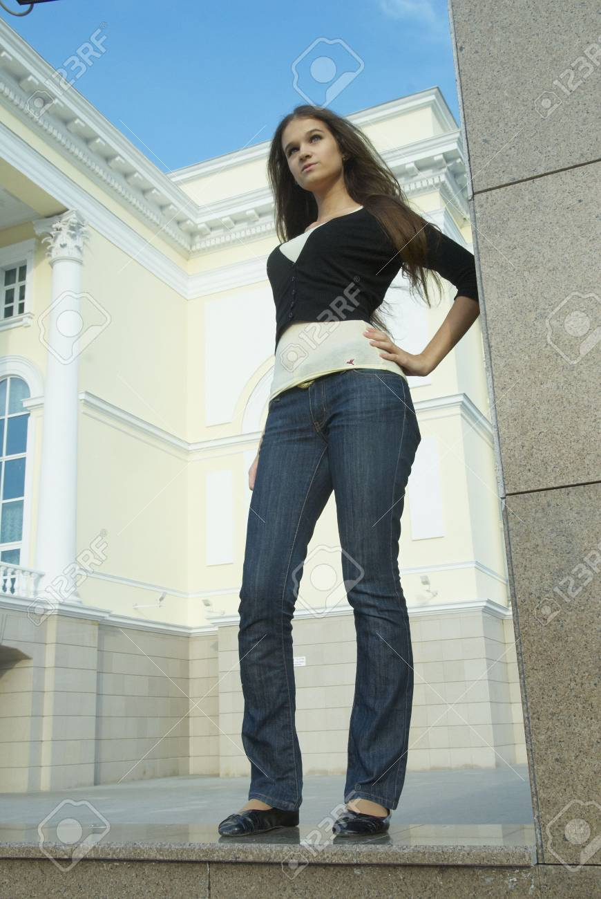 Young woman at city theatre background Stock Photo - 6017334