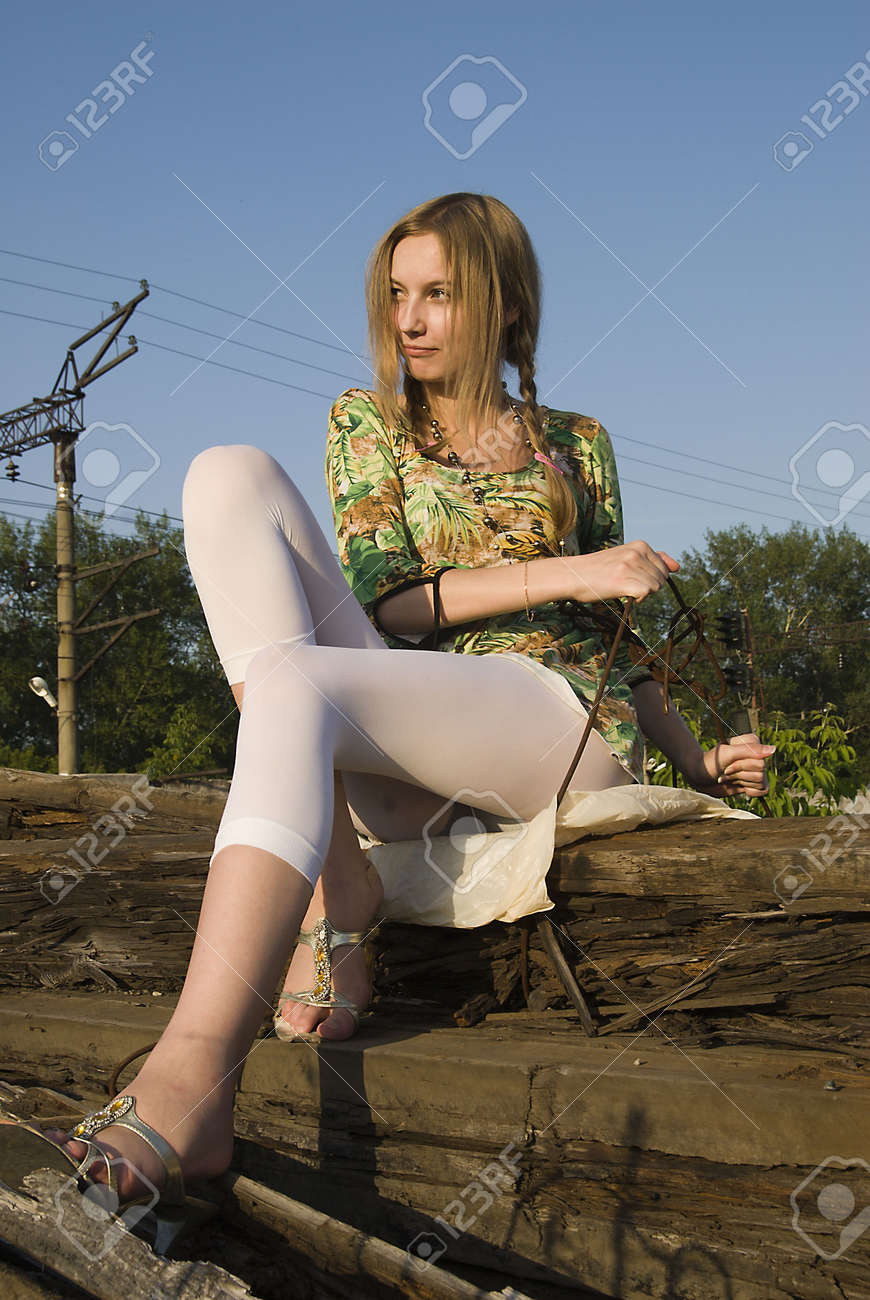 Young woman sitting on old railway cross tie Stock Photo - 6433582