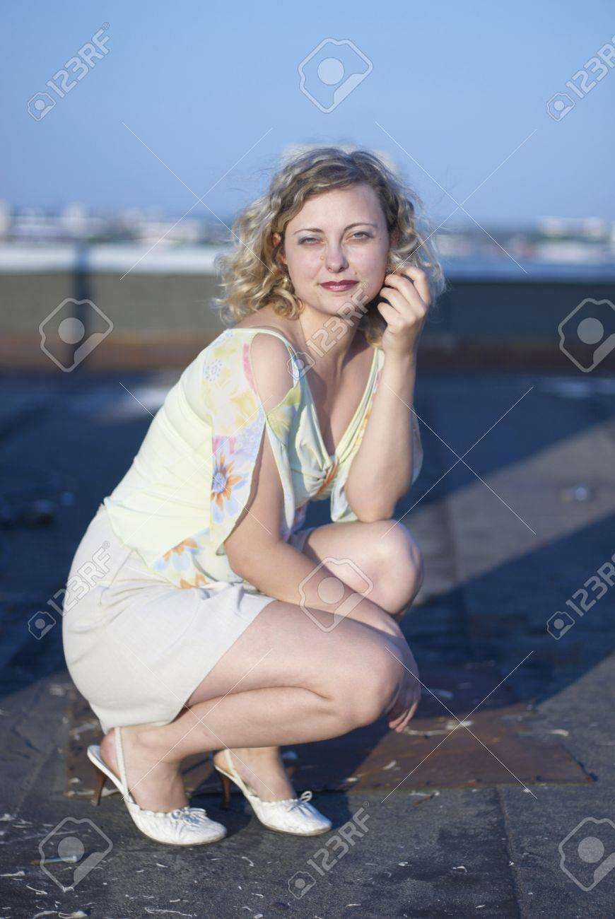 Pretty girl on roof Stock Photo - 12373726