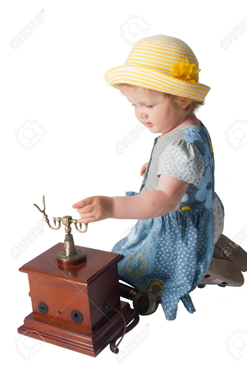 Little girl speaking by wired retro phone, Isolated on white Stock Photo - 15018190