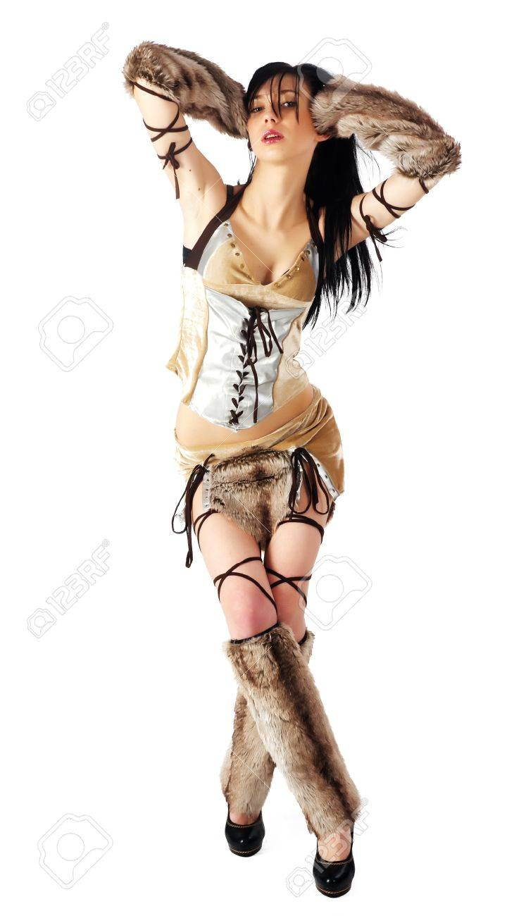 Young beautiful woman in barbarian costume  Isolated on white Stock Photo - 16785511