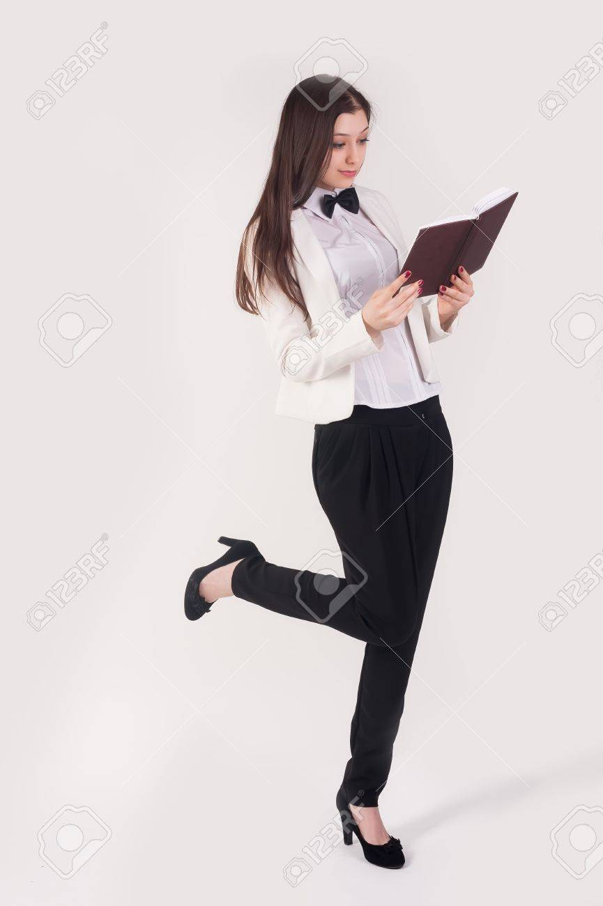 Portrait of pretty playful student or businesswoman in smart casual with  organizer at white background Stock