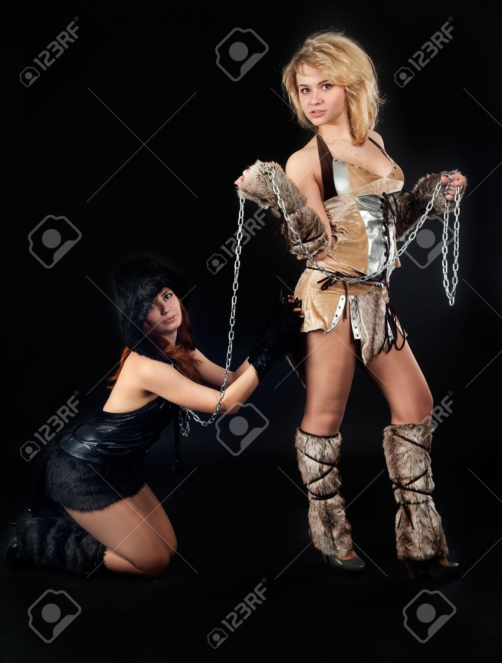 eoung beautiful women in barbarian and cat costumes on black background Stock Photo - 22109367  sc 1 st  123RF.com & Eoung Beautiful Women In Barbarian And Cat Costumes On Black.. Stock ...