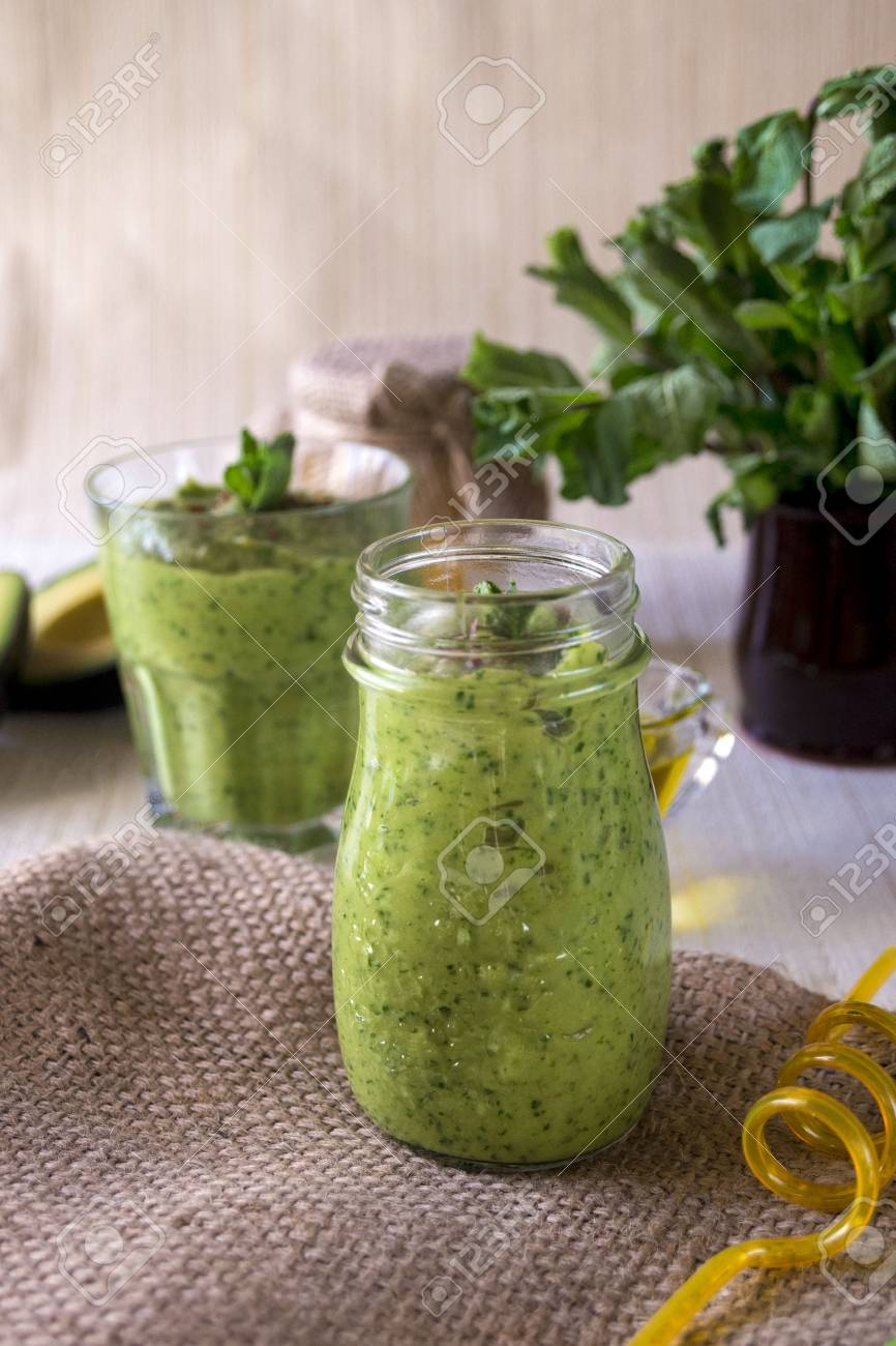 Thick nutritious smoothies, which include: avocado, apple, banana, spinach, orange juice, honey, flax seeds, mint and olive oil. Proper nutrition. Healthy lifestyle. - 123652874
