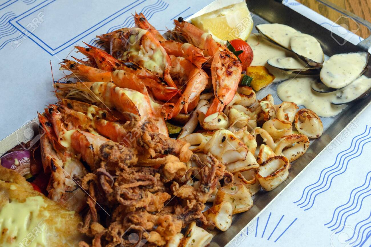 Fried Seafood Platter Shrimp Squid Fish And Vegetables In Stock Photo Picture And Royalty Free Image Image 140674874