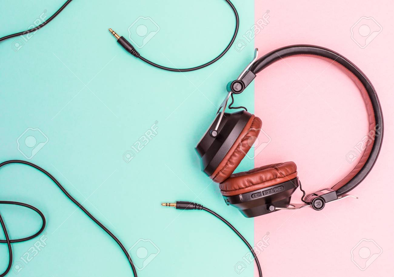 Fancy Headphones Laying On A Flat Pink And Blue Surface. Analog ...