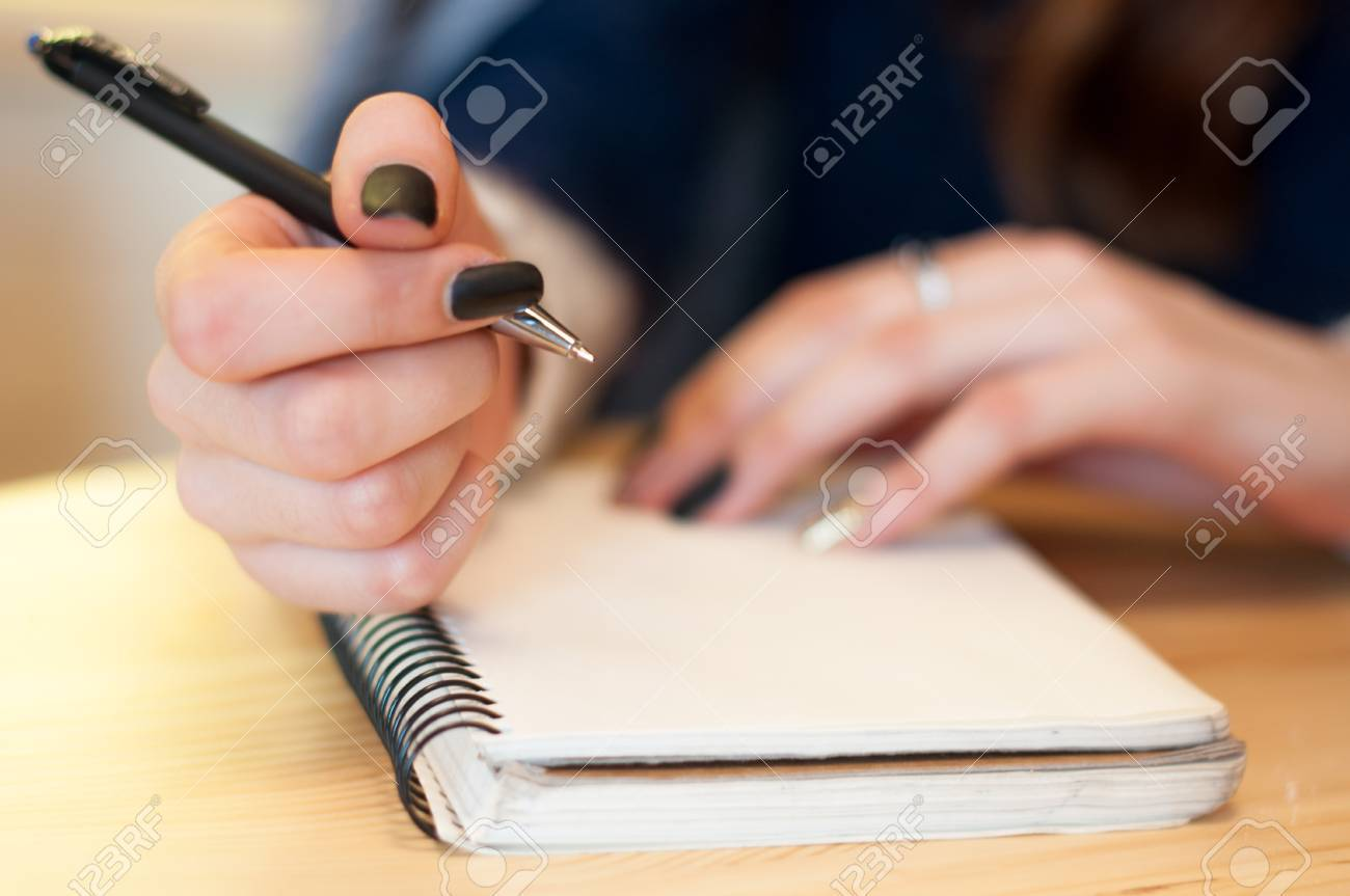 paper in business woman beautiful female hand writing notes on