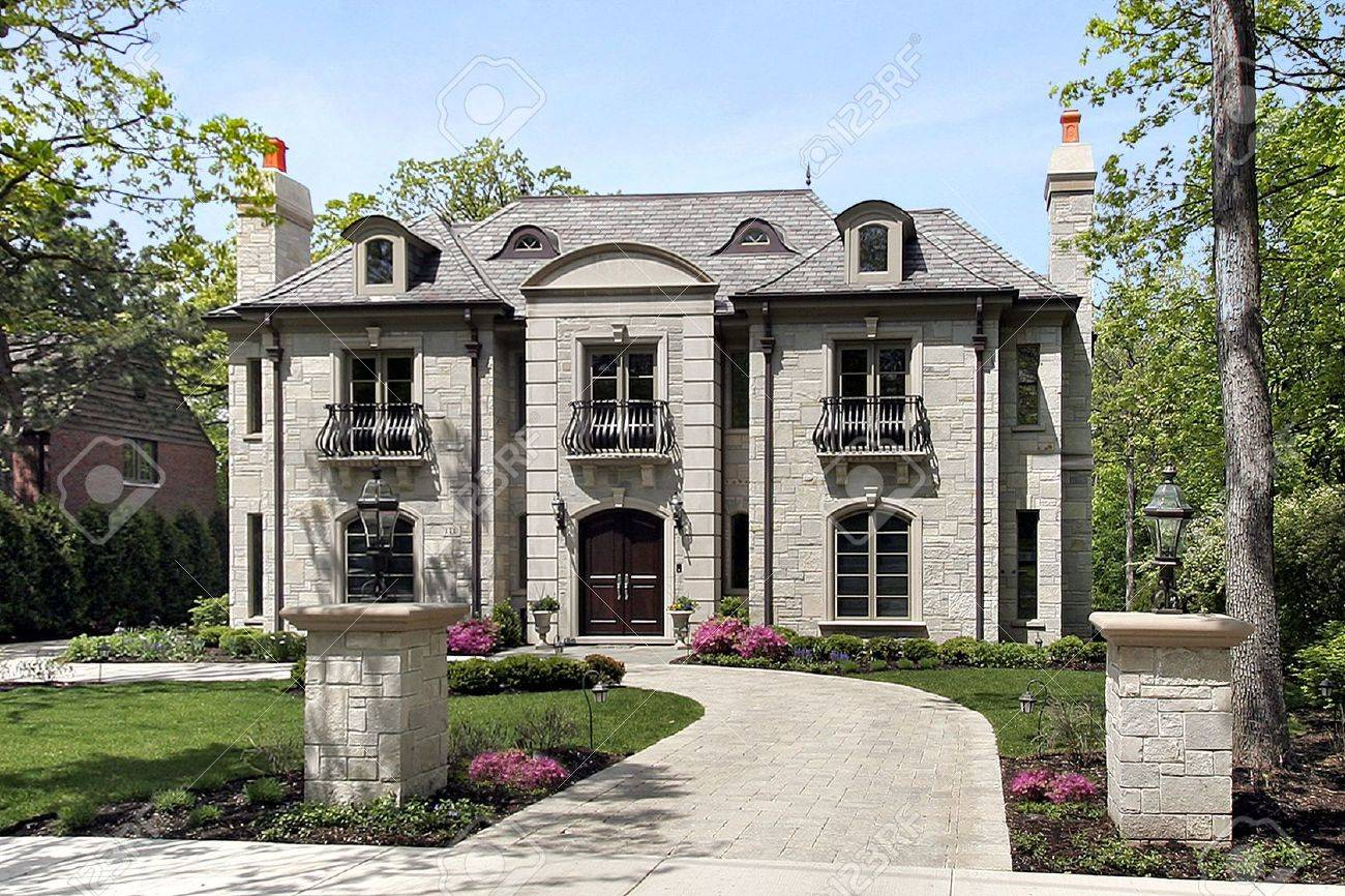 luxury home exterior luxury stone home with circular driveway and pillars