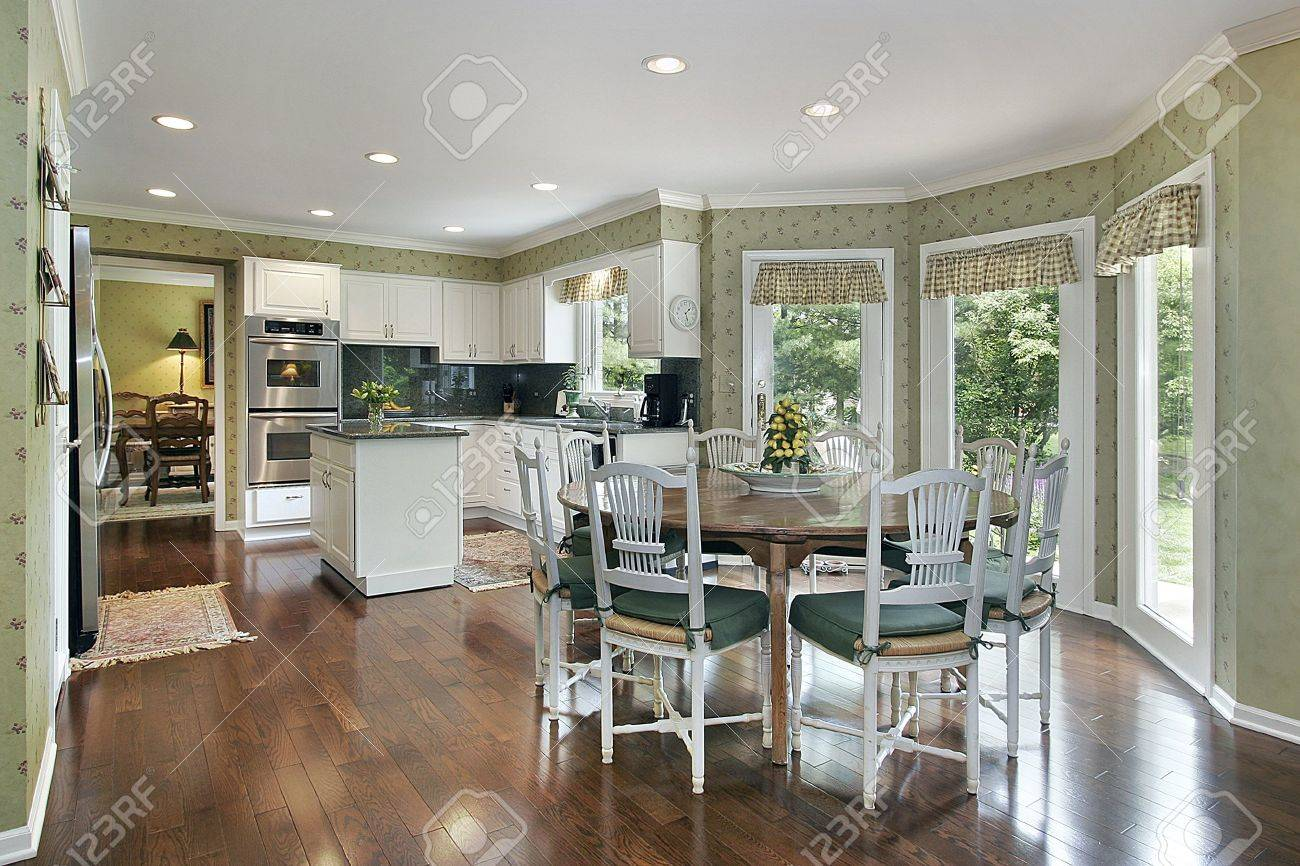 Kitchen Eating Area Green Tone Kitchen With Island And Eating Area Stock Photo
