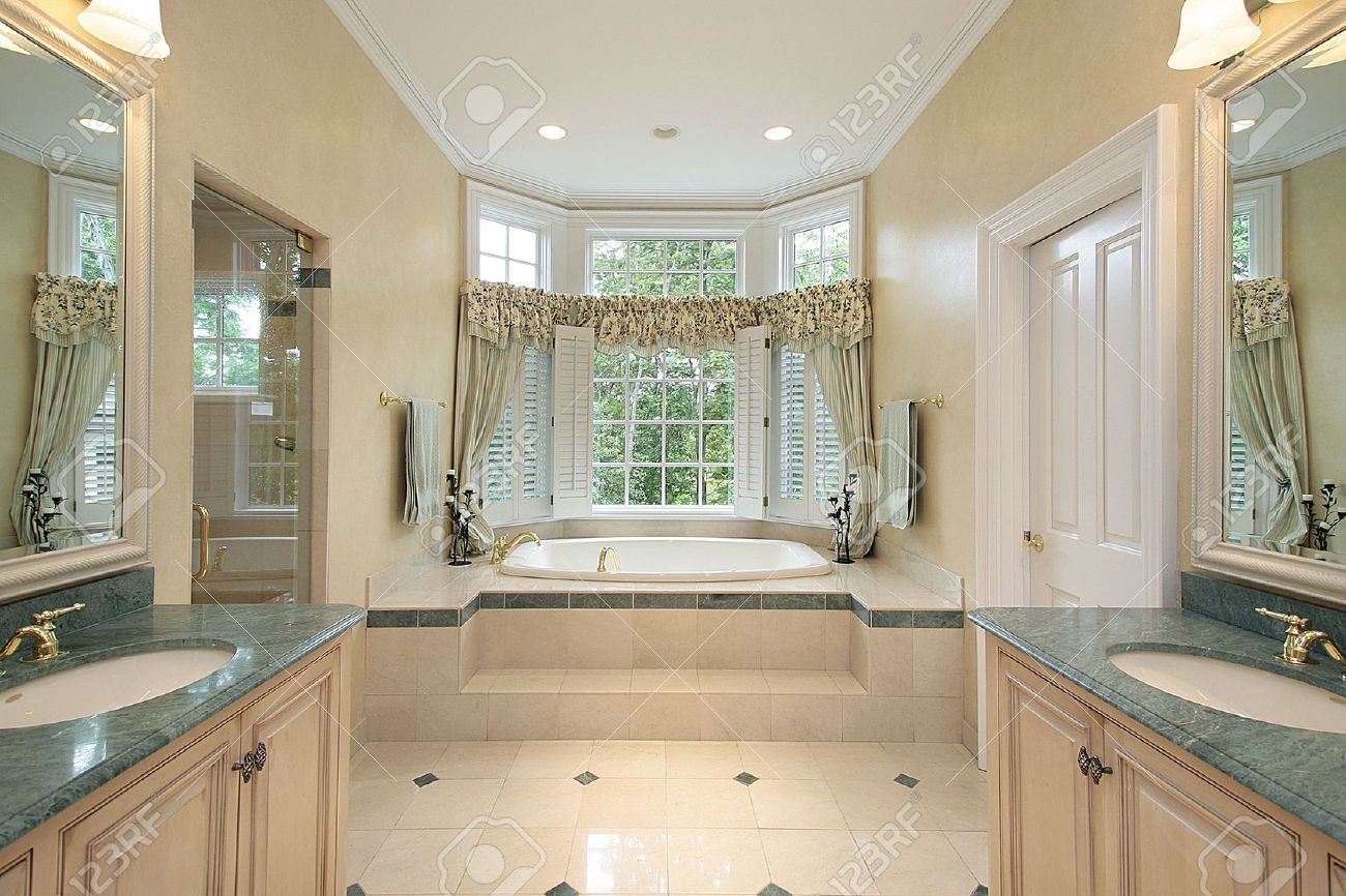 master bath in luxury home with step up tub stock photo picture