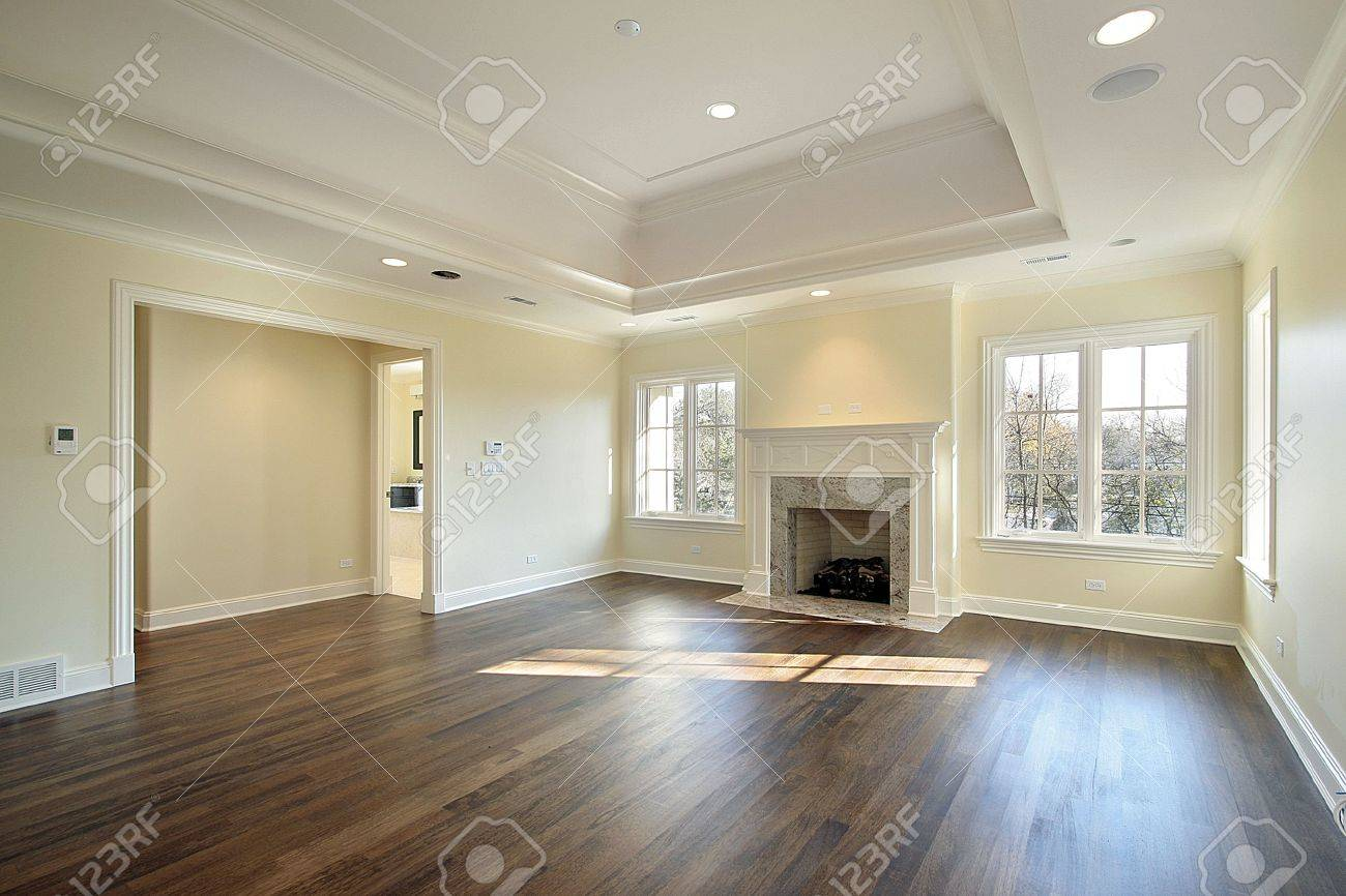 master bedroom in new construction home with fireplace stock photo