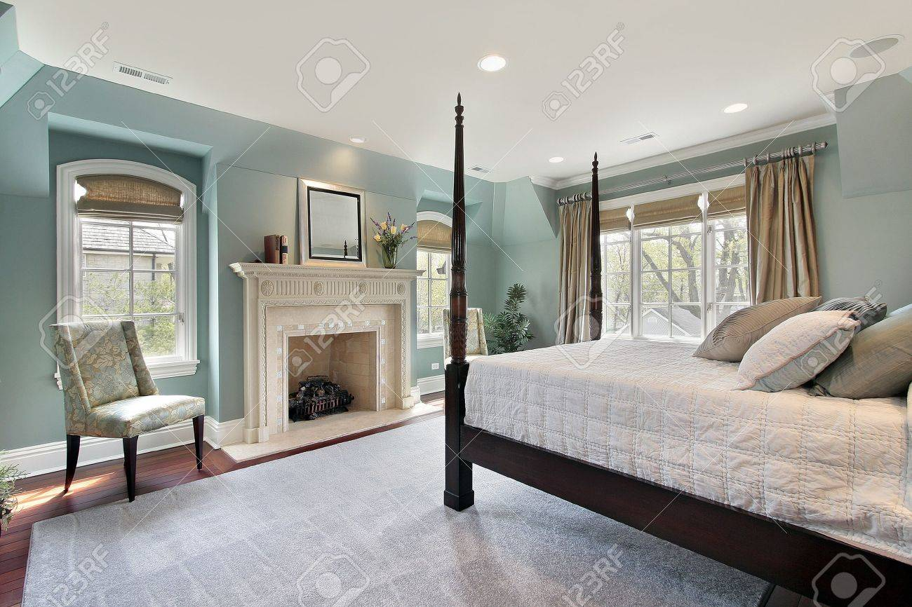 Master Bedroom In Luxury Home With Marble Fireplace Stock Photo   6760849