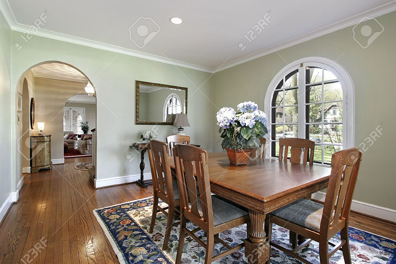 dining room with green walls and arch stock photo, picture and