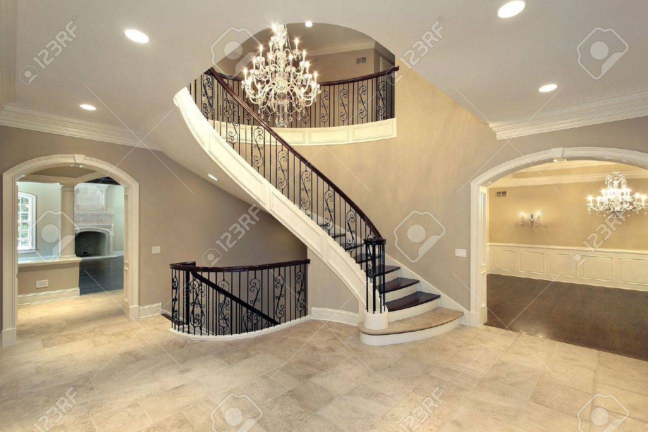 Foyer With Curved Stairway In New Construction Home Stock Photo   6733524