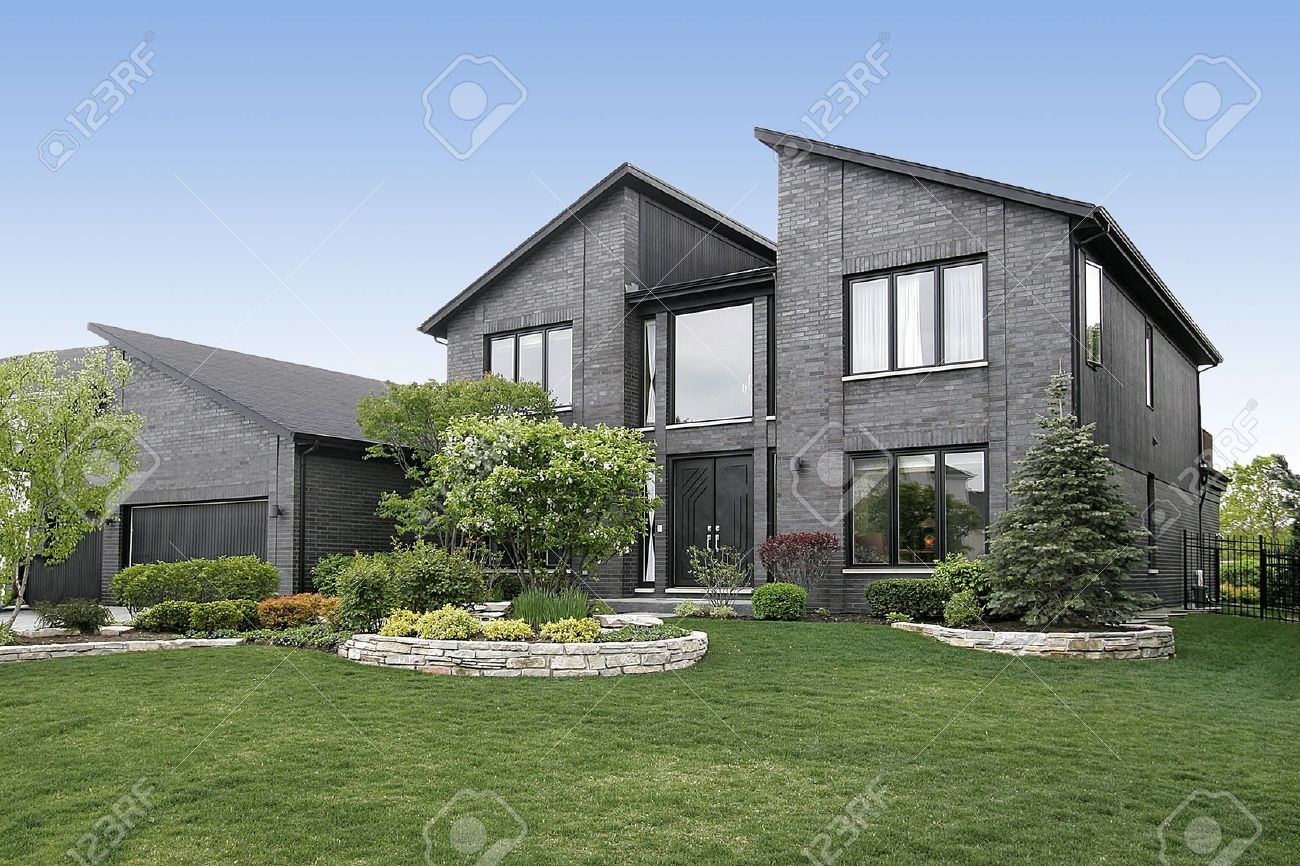 Modern Home With Gray Brick And Black Door Stock Photo, Picture ...
